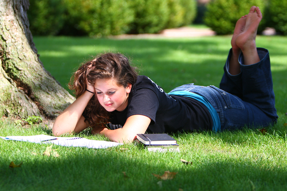 Caroline studying on the quad