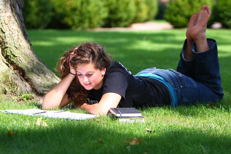 Caroline studying on the quad