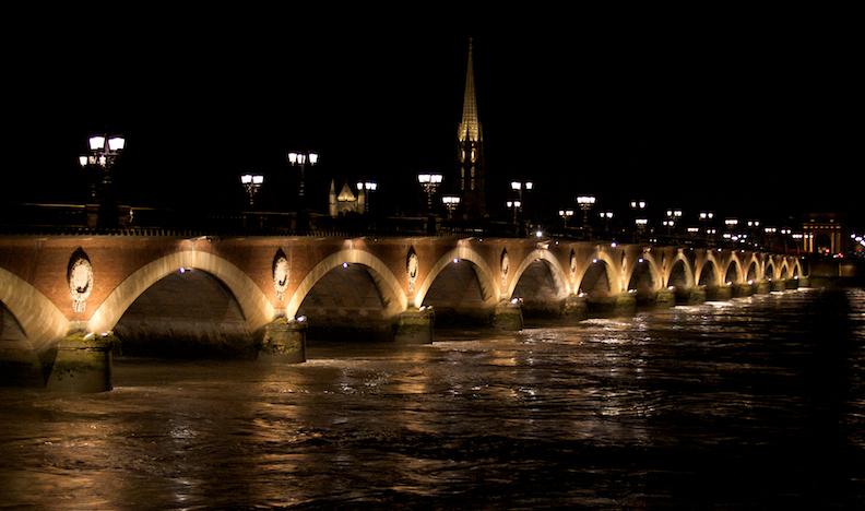 Pont de Pierre bridge at night
